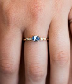 Do you need the perfect pop of color to compliment your favorite outfit? Look no further. This mesmerizing oval ceylon sapphire is perfectly complimented by two 1.5mm diamonds on each side. The 14k ye
