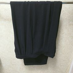 """JH Collectables dressy pants Beautiful flowy black pants with a thin stripe of sparkling silver. Gentle pleats in front and back. Pockets.  Waist has elastic insets in back. Cuffed.  Excellent condition.  Inseam is 29"""". JH Collectables Pants"""