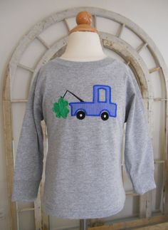 Inspiration for K's St. Patrick's Day shirt.  The truck will be lifting a separate, attached puffy shamrock from a pocket on the t-shirt