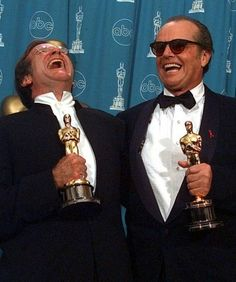 Jack Nicholson, right, and Robin Williams share a laugh as they pose with their Oscars