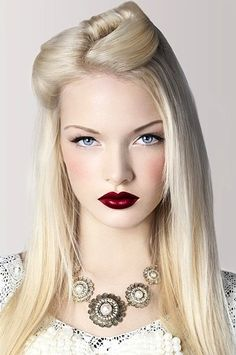 Flawless skin paired with a deep scarlet lips!