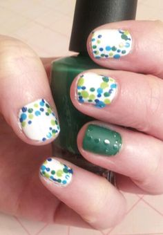 Amy's other hand. Polka dot Mani with matte accent nail.