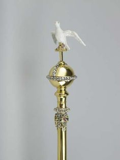 Sceptre with the Dove. An introductory exhibition will feature evocative graphics, music and film footage which will enable visitors to explore the importance of the crown jewels to the British monarchy. The sceptre was originally made for King Charles II's coronation in 1661, to symbolise the authority of the monarch under the cross. The enamelled dove represents the Holy Ghost, and the sceptre is meant to be held in the left hand, whilst the Sceptre with the Cross is held in the right