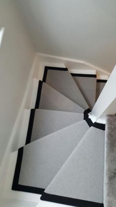 Client: Private Residence In East London Brief: To supply & install grey carpet with a black border to stairs