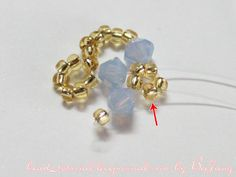 """Tutorial : Crystal Bracelet #20 Level : Intermediate Technique : Cross-weaving The design is from the book """"Rocca #4 """". This is similar to this bracelet . I think it is lovely so I make one and prepare a tutorial for you here. Equipment : - Swarovski Bicone Crystal 4 mm. - Seed Bead 11/O…"""