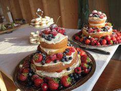 Naked Victorian sponge cake with mascarpone filling and fresh Swedish berries