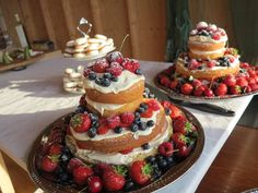 Naked Victorian sponge cake with mascarpone filling and fresh Swedish berries