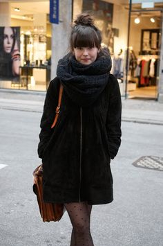 Tights, bun, scarf, dimples…Love everything. (Via Copenhagen Street Style)