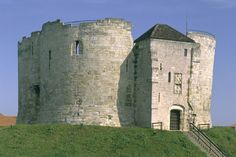 Clifford's Tower, York.Set on a tall mound in the heart of Old York, this imposing tower is almost all that remains of York Castle, which was originally built by William the Conqueror.   | English Heritage