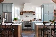 Nothing says a kitchen built for entertaining like double kitchen islands. Splitting them up creates a direct walkway to the stove and the refrigerator without compromising the extra storage and countertop space of a large island.