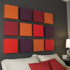 Make your own graphic focal point above the bed with a grid of boxe