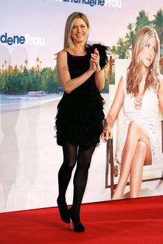 Pin for Later: Jennifer Aniston Paints the Town Black: 46 Noteworthy Noir Looks  For the Berlin premiere of Just Go With It, the leading lady chose a tulle ruffled Nina Ricci creation, opaque black tights, and sky-high pumps.