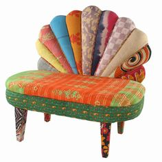 Peacock settee with a mango wood frame and reclaimed vintage kantha cloth upholstery.    Product: SetteeConstruction Mat...