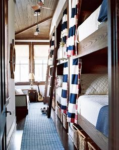 Love this sleep space!  Extra beds at a beach home perhaps?  Sleeps up to 6 kids - love the striped nautical curtains on each bunk!