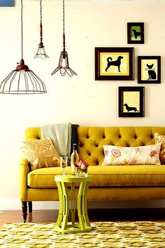The animal prints are slightly weird, but that mustard tufted couch is amazing