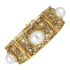 M. Buccellati Pearl Diamond Gold Bracelet. Two tone 18 karat white and yellow gold open work bracelet set with five 11.50-11.75mm South Sea pearls and full cut diamond accents, signed M. Buccellati.