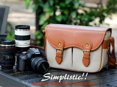 *Color: Pale Grey  *Material: Top quality canvas & PU Leather   *Hardness: Medium soft   *Padded camera insert can be removable  *Can place 1 camera body & 2 Lens  *The shoulder strap can be adjustable  *To apply a gender: unisex   * Smart Appearance    --------------------------------------   Si...