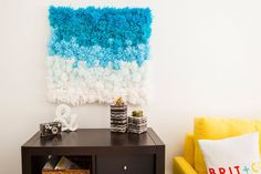 Here at Brit + Co., we recently bonded over how much we all love pom poms. Each of us had a memory attached to the mindless activity of making them out of spools of yarn, so we put our brains together and came up with an awesome idea: use pom poms to make one stellar project that can be used around the house three ways—as a rug, a wall hanging or a coffee table runner. Now we're not going to lie, this project takes some time. Make sure you have a free weekend or a lot of friends who are…