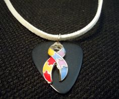 Autism Awareness Ribbon on a Black Guitar Pick with White Velvet Cord Necklace by ItsYourPick on Etsy
