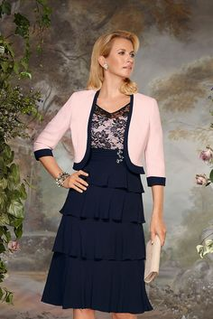 70836 (Condici) Georgette dress with bolero jacket in Navy & Flamingo. The dress has a lace bodice, lace sleeves and beaded detailing to the waist. The skirt has soft floaty layers and is knee length. The matching Crepe jacket has Read More...