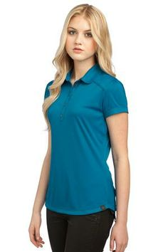 OGIO® Vamp Polo. Use your feminine wiles for good in this polo that features pleats and picot trim details.  - Arizona Cap Company - (480) 661-0540 Custom Printed & Embroidered. Visit our website for the colors available and the price.