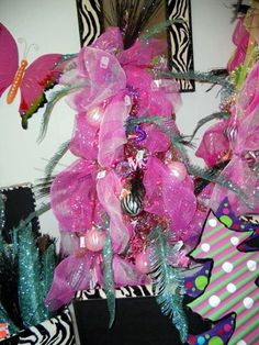 These pink divas Christmas trees from one of our supplier's showroom has used pink as the primary ribbon color and zebra print accents. The blue touches are a plastic glittered fern leaf. More inspiration at Trendy Tree Valentine Decorations, Christmas Tree Decorations, Christmas Trees, Wreath Making Supplies, Christmas Tree Inspiration, Whimsical Christmas, Tree Shapes, Wreath Forms, Trendy Tree