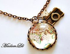"Nostalgic bronze necklace with bronze ""Vintage Worldmap"" collage pendant, camera charm and faceted glass bead.     Pendant with glass-finish and glass"