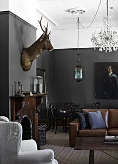 Living room in a holiday rental: Ellis House. Located at Kyneton, about an hour from Melbourne, this 1860's four bedroom home has been renovated in a moody palette with lots of texture and rich details.