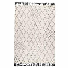 Tapis coton épais 120x180 esprit berbère noir et écru signé IB Laursen. Un modèle de tapis dans l'air du temps. Joli détail des franges noires contrastant avec le fond écru.