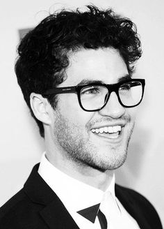 Brown curly hair + big glasses framing beautiful eyes + some sexy stubble + and a killer smile = DARREN CRISS....thats maths I understand :)