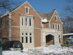Smooth panels of Indiana Limestone combined with brick by CWB MTL, via Flickr