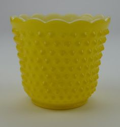 This vintage Fire-King vase is made of glass and stands 5 inches tall. It has a yellow exterior with a hobnail finish and a smooth white interior and Yellow Vase, Color Yellow, Colour, Vintage Fire King, Opaline, Carnival Glass, Pyrex, Milk Glass, Colored Glass