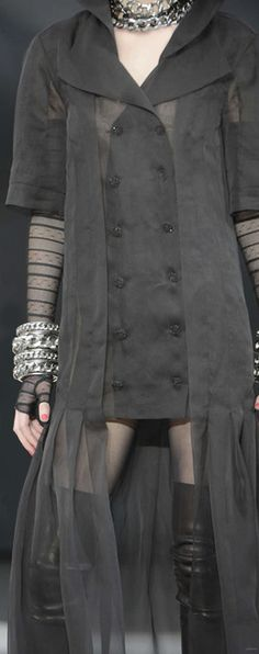 Chanel ... I like the overskirt-see through coat-ish thing.  Not crazy about the double-breasted look.  Very elegant.