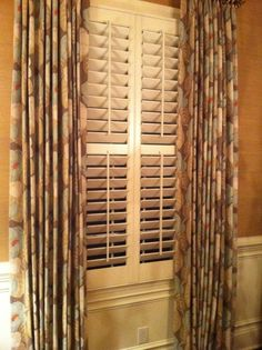 plantation shutters with window treatments