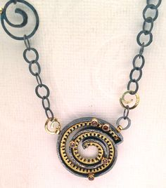 Necklace with 22k, oxidized silver and andalusite