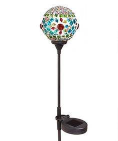 Iridescent tiles dance across the head of this solar-powered garden stake for a whimsical touch to your outdoor space.