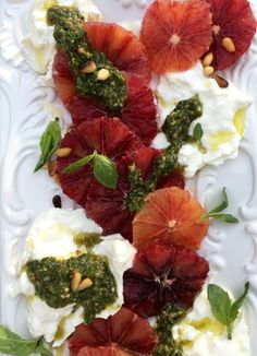 An Italian blood orange salad recipe with creamy burrata cheese, basil pesto and pine nuts.