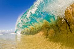 Photo of a wave by Clark Little.  If one was going to take a picture of a wave, it would be hard to improve on this.