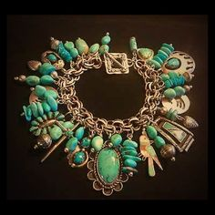 Vintage Navajo Sterling Turquoise Charm Bracelet Incredibly captivating vintage Navajo turquoise & sterling charm bracelet.Loaded with vintage Native American pendants and charms. The pendants include a large pendant with scalloped edges, and big perfectly blue turquoise stone, as the centerpiece, surrounded by a sweet inlaid bird, a couple of shadow box pendants, a lovely old sterling cross, a large bear claw pendant. A couple of the pendants are signed, including a pretty cluster pendant…