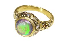 "Alex Sepkus ""Circle"" ring in yellow gold with a ct. fine black crystal opal from the Lightning Ridge opal fields in Australia. Cross Jewelry, Opal Jewelry, Pendant Earrings, Ring Earrings, Thing 1, Black Crystals, Colored Diamonds, Gemstone Rings, Jewels"