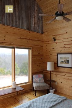 Interior view of master bedroom showing galvanized metal roof decking as upper paneling. Metal was aged with pickle juice. Modern mountain farmhouse, cabin, corten steel metal roofing, cedar siding, pine paneling interior, marvin windows and doors, casement windows, glulam beams, tongue and groove floor decking, tongue and groove roof deck, SIPs panels, stained concrete floor, open floor plan, loft, alternating tread stair, architectural design, architect, mountain views, front porch, Stained Concrete, Concrete Floors, Casement Windows, Windows And Doors, Design Architect, Architecture Design, Galvanized Metal Roof, Sips Panels, Marvin Windows