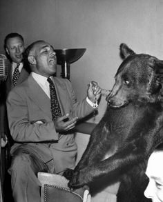 Stanley Beebe sings to an evidently alarmed Rosie the bear, 1946.