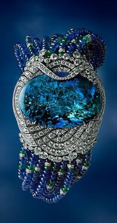 This cabochon-cut black opal bracelet by Cartier is set with diamonds in platinum accented with sapphire and emerald beads.