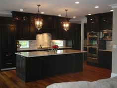 21 Dark Cabinet Kitchen Designs    ...love the dark cabinet with whitish granite and love these hanging lamps