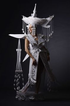 asya kozina channels the motifs, costumes and aesthetic characteristics of various historical time periods and recreates them using the medium of paper.