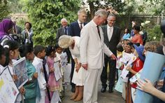 Prince Charles and his wife Camilla, Duchess of Cornwall, chat with children during an event to celebrate his birthday, in Colombo Photo: REUTERS