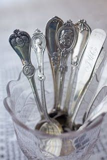 love spoons in a glass spoon holder - God parents, grandmother and mother all kept spoons this way - I have one in my china cabinet that I keep just for 'love'