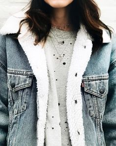 worn out tee shirt and a denim jacket with sherpa lining