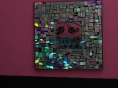 Turn the wrong side of an old CD into a Mosaic Mirror or Picture Frame.