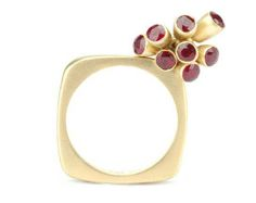 Mirri Damer gold square ring featuring seven moving ruby buds.